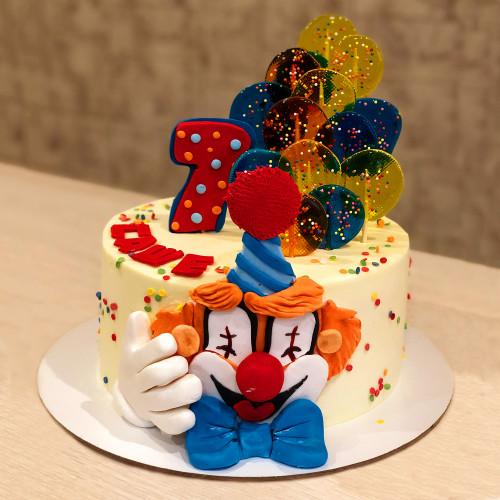 Торт с клоуном и леденцами