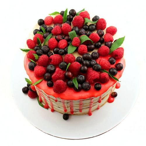 Открытый торт с малиной